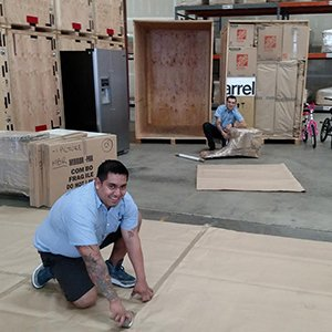 Moving Team Working to Prepare Items for Storage