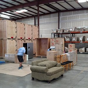 Moving Professionals Prepare Furniture for Storage