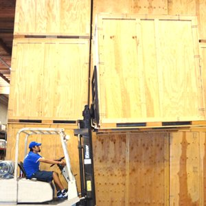 Certified Pro Movers Operating Forklift for Storage