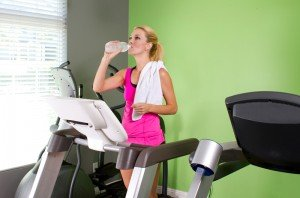 Woman Ready to Move her Home Exercise Machines